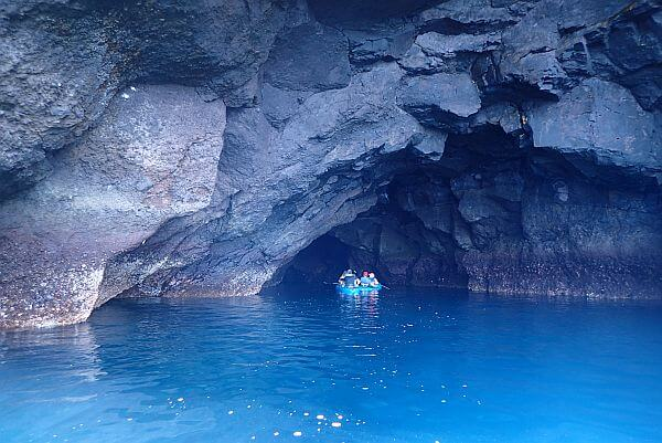 zodiac exploring a cave in the Galapagos
