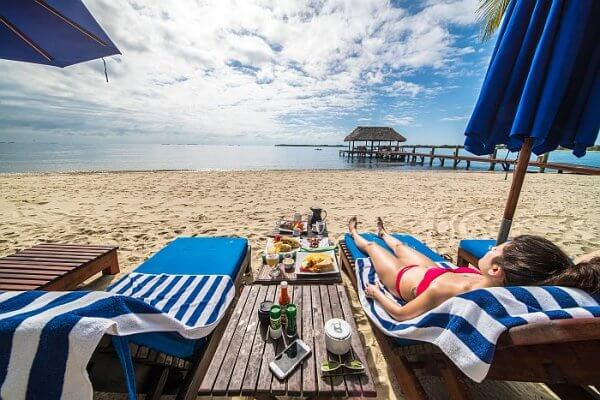 private dining on the beach in Belize with roaming butler