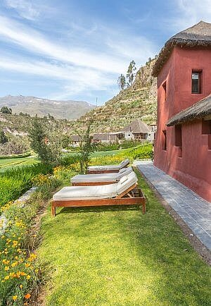 Lounge chairs with a view at Colca Lodge, Spa, and Hot Springs in Peru