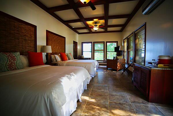 Cabana bedroom at the former Hatchet Caye private island resort in Belize