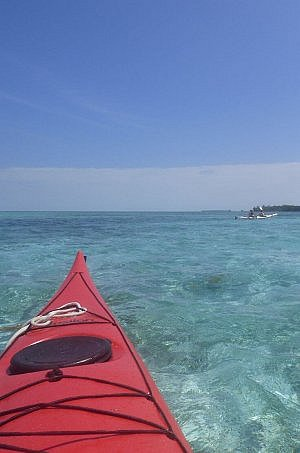Paddling in a kayak in Belize around Glover's Atoll with Island Expeditions