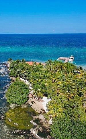 Ray Caye Resort in Belize from above - a private island resort on the longest coral reef in the Americas.