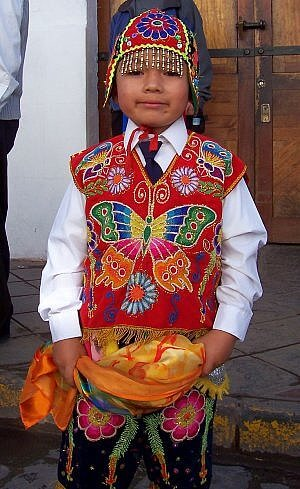 On a tour of Peru you may find a parade with colorful costumes like this one in Quito