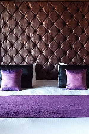 Guest room bed in boutique Hotel Nena in central Mexico