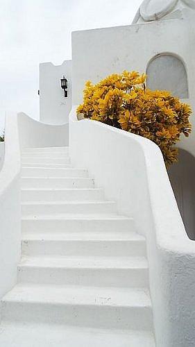 Las Hadas Manzanillo resort with whitewashed buildings facing a bay on the Pacific Ocean