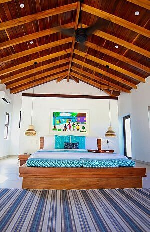 Naia Belize luxury resort and spa room in Placencia, all on the country's best beach.