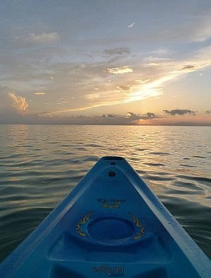 kayak at sunset near Thatch Caye Belize resort